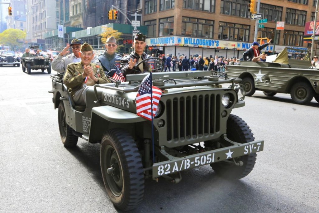 Veterans salute while riding a jeep during the Veterans Day parade on 5th Avenue in New York November 11, 2014. (Gordon Donovan/Yahoo News)